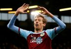 Former England striker Crouch announces retirement