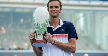 Marathon man Medvedev beats Goffin for Cincinnati crown