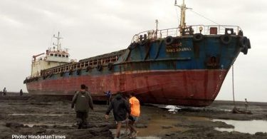 Cargo ship beached by storm, western India