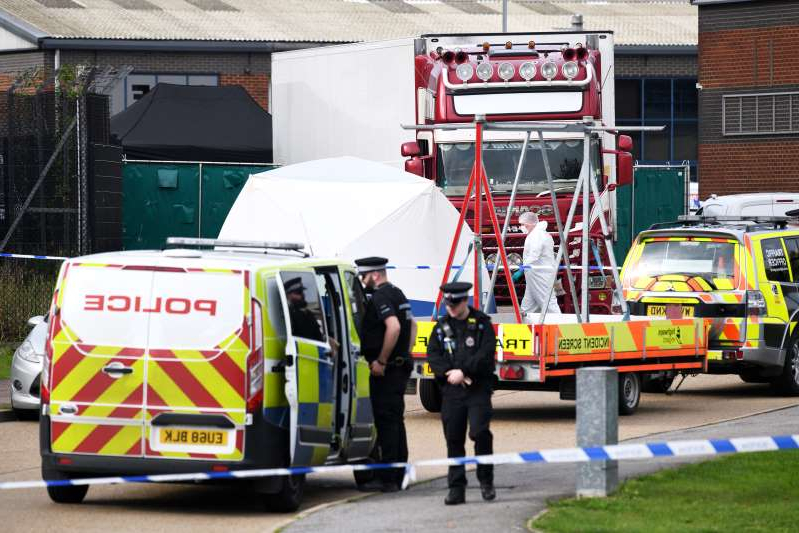 Truck driver found with 39 bodies appears in British court