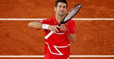 Djokovic survives Tsitsipas challenge to set up Nadal final at French Open