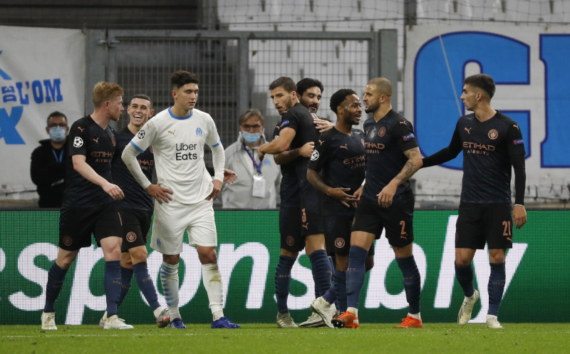 Manchester City thrash woeful Marseille to stay group leaders in Champions League