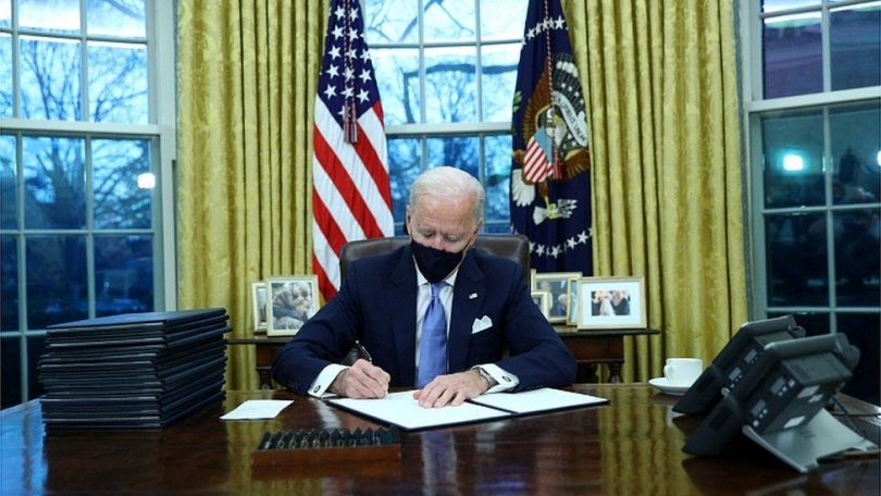 On first day Biden issues orders undoing key Trump policies